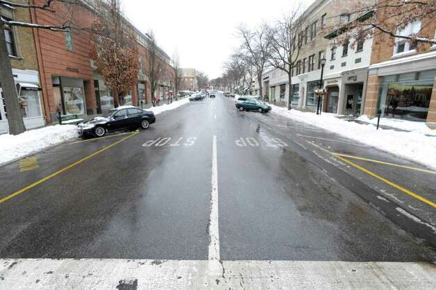 No visible signs of snow on Greenwich Avenue during aftermath of the snowstorm early Wednesday afternoon, Jan. 12, 2011. Photo: Bob Luckey / Greenwich Time
