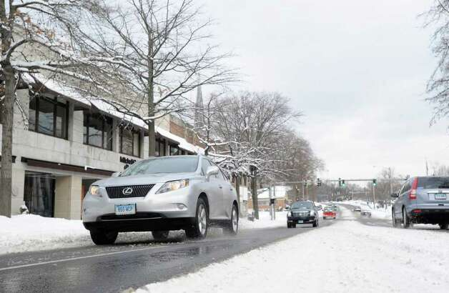 East Putnam Avenue early Wednesday afternoon during the aftemath of snowstorm, Jan. 12, 2011. Photo: Bob Luckey / Greenwich Time