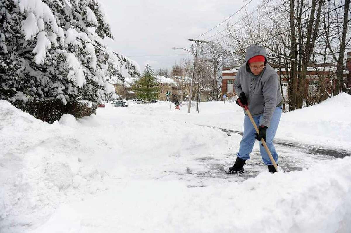 Laurah Hardy shovels the street beyond her driveway on Hillside Street in Norwalk on Wednesday, January 12, 2011.