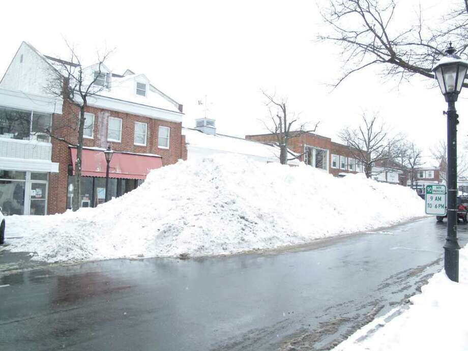 A snow mountain covering half of Elm Street. Photo: Contributed Photo;Paresh Jha Staff Photo, Contributed Photo / New Canaan News