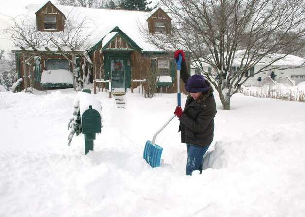 Hopeful there will be delivery today, Carolyn Doruka shovels a clearing around her mailbox on Judd St.in Fairfield, Conn. on Wednesday Jan. 12, 2011. Photo: Cathy Zuraw / Connecticut Post