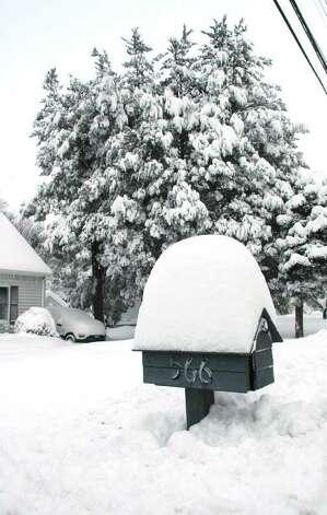 Snow was piled high on Stillson Rd.in Fairfield, Conn. on Wednesday, Jan. 12, 2011. Photo: Cathy Zuraw / Connecticut Post
