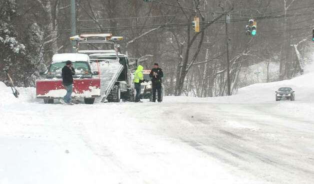One unlucky driver had his plow break down on Black Rock Turnpike in Fairfield, Conn. on Wednesday, Jan. 12, 2011. Photo: Cathy Zuraw / Connecticut Post
