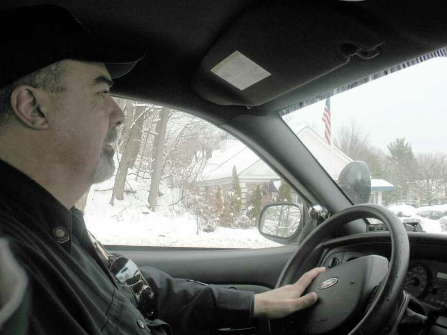 Sgt. Michael O'Connor, a veteran of the Greenwich Police Department, supervises the patrol units on the east side of town Wednesday. O'Connor said the snowstorm presented no real problems in town. Photo by Debra Friedman/staff Photo: Contributed Photo / Greenwich Time Contributed