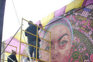 "Ruth Buentello, left and John Montez work on ""End Barrio Warfare,"" located at 1401 S. Brazos St. It will be unveiled Jan. 22.       Normal   0       false   false   false                 MicrosoftInternetExplorer4                