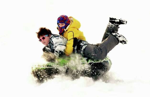 Jack Leblank, 13, left, and Chris Sam, 12, both of Danbury, hit the jump hard at Richter Park in Danbury, Wednesday, Jan. 12, 2010. Photo: Michael Duffy / The News-Times