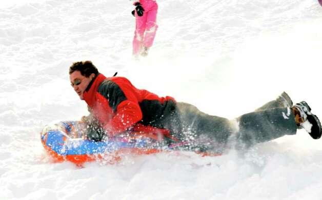 Jim Gherna, of Danbury, sleds at Richter Park in Danbury, Wednesday, Jan. 12, 2010. Photo: Michael Duffy / The News-Times