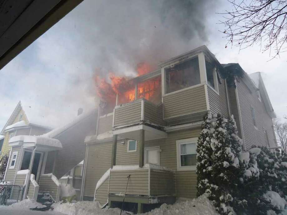 A fire on the third floor of a Myrtle Street home ripped through a two-family house Wednesday morning and left six residents displaced. No one was injured, but the fire burnt through the third and second stories of the home and left it uninhabitable. Photo: Contributed Photo / Stamford Advocate Contributed