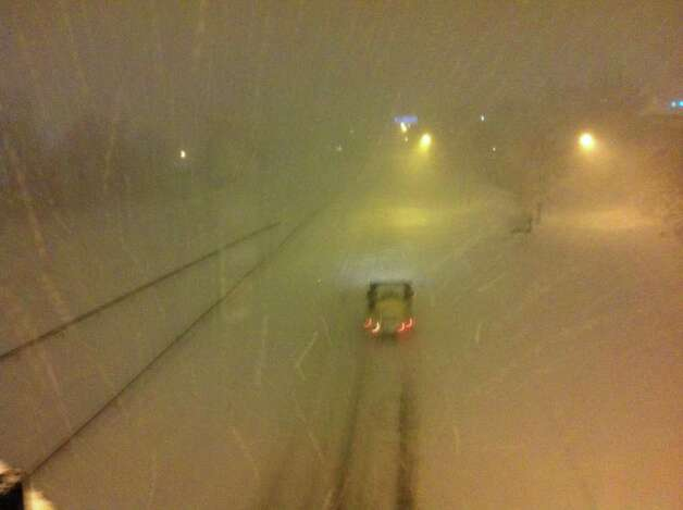 A lone truck drives on an otherwise vacant and snow-covered Route 8 in Bridgeport on Wednesday, Jan. 12, 2011 as blizzard-like conditions hit Southwestern Connecticut. Photo: Ben Doody / Connecticut Post