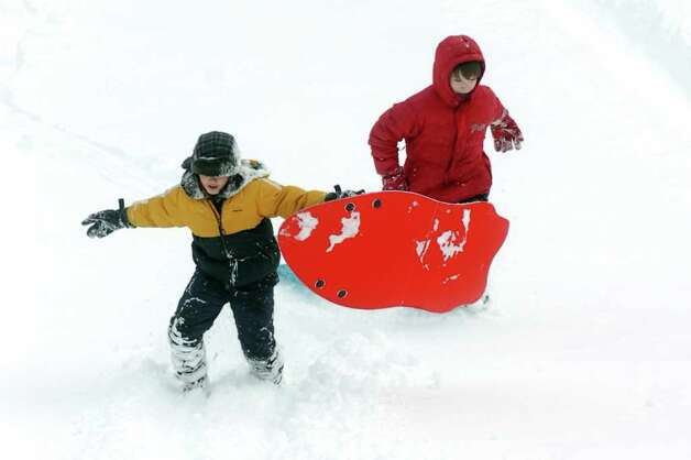 Josh Duffy and Anthony Eklund, both 10, sled in Boothe Memorial Park in Stratford, Conn. Wednesday, Jan. 12th, 2011. Photo: Ned Gerard / Connecticut Post