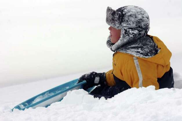 Josh Duffy rests while sledding in Boothe Memorial Park in Stratford, Conn. Wednesday, Jan. 12th, 2011. Photo: Ned Gerard / Connecticut Post