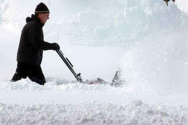 John Terrill plows snow from a sidewalk on Main St. in Stratford, Conn. Wednesday, Jan. 12th, 2011. Photo: Ned Gerard / Connecticut Post