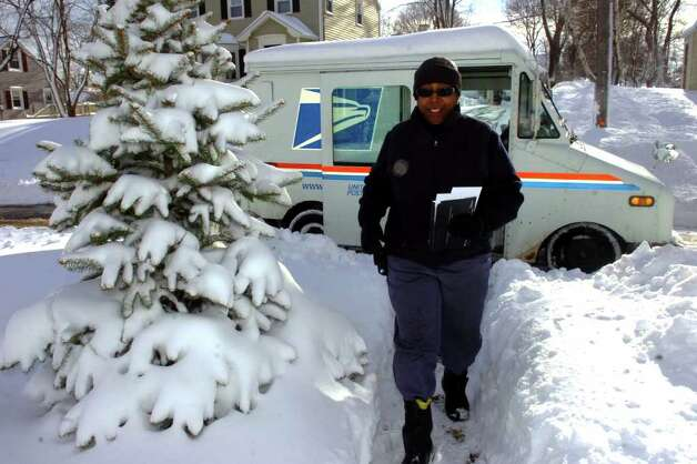 Val Hairston delivers mail on Luaghlin Rd. East in Stratford, Conn. Wednesday, Jan. 12th, 2011. Photo: Ned Gerard / Connecticut Post