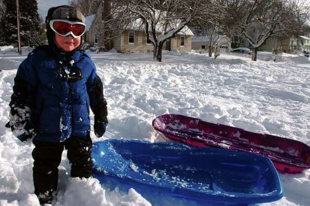 A young sledder along East Parkway in Stratford, Conn. Wednesday, Jan. 12th, 2011. Photo: Ned Gerard / Connecticut Post