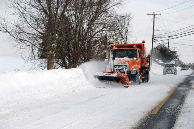 A snow plow works its way down Route 25 in Newtown early Wednesday afternoon, January 12, 2011. Photo: Carol Kaliff / The News-Times