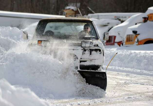 Daniel Amaral, owner of Amaral Motors in Newtown plows the driveway and parking  lot of his business Wednesday, January 12, 2011. Photo: Carol Kaliff / The News-Times