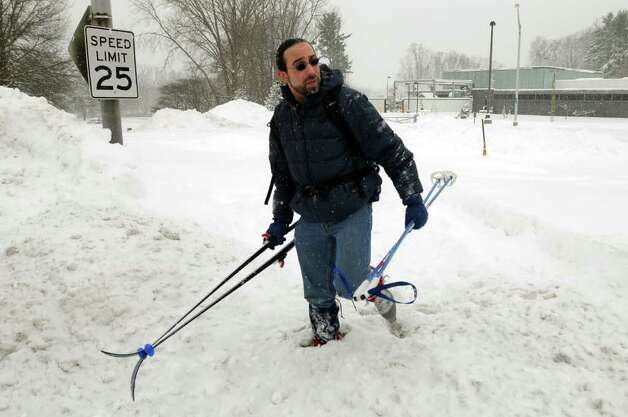 Traffic engineer Brian Menyuk looks to cross the road after cross country skiing into work on Wednesday, Jan. 12, 2011, at the Harriman State Campus in Albany, N.Y. Menyuk, who lives in Rensselaer, said he skied about seven miles, including a trip over the Dunn Memorial Bridge. (Cindy Schultz / Times Union) Photo: Cindy Schultz