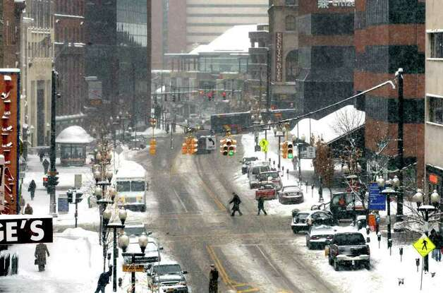 A slow and snow covered Pearl Steet in Albany Wednesday afternoon Jan. 122011.( Michael P. Farrell/Times Union ) Photo: Michael P. Farrell