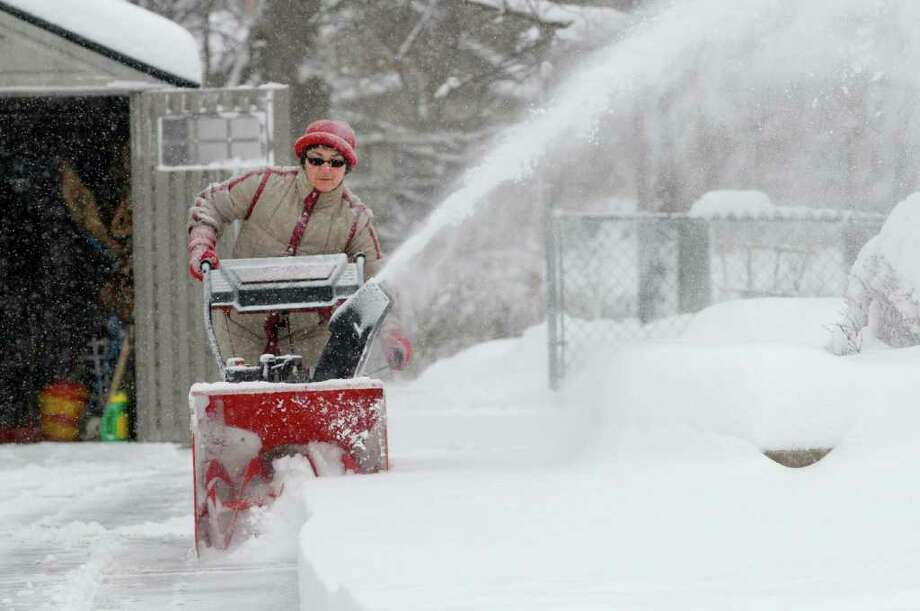 Gilda Fake uses her snowblower to clear her driveway in East Greenbush, NY on Wednesday, Jan. 12, 2011.  (Paul Buckowski / Times Union) Photo: Paul Buckowski / 10011727A
