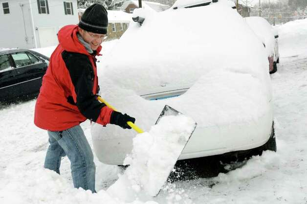Michal Jacyna gets his exercise as he shovels out his car during a snow storm on Wednesday, Jan. 12, 2011, at his home in Albany, N.Y. (Cindy Schultz / Times Union) Photo: Cindy Schultz
