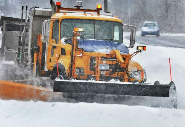 Snowplows on Central Ave. at Wolf Road in Colonie Wednesday January 12, 2011.   (John Carl D'Annibale / Times Union) Photo: John Carl D'Annibale / 10011727A