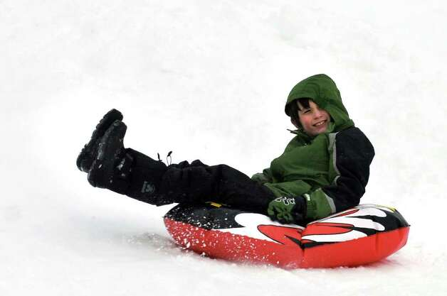 Ezra Jones, 9, of Albany sleigh rides on Wednesday, Jan. 12, 2011, at Capital Hills Golf Course in Albany, N.Y. (Cindy Schultz / Times Union) Photo: Cindy Schultz