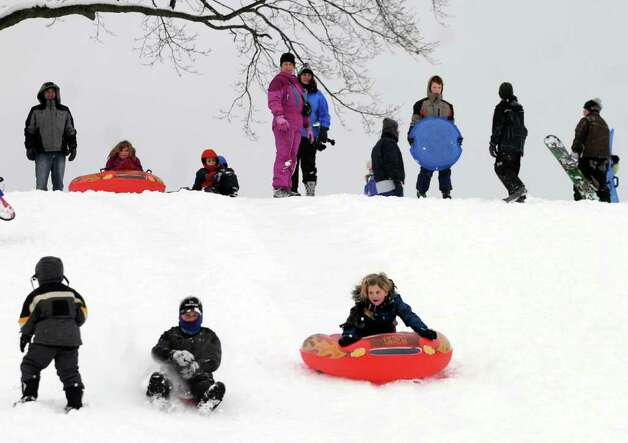 Children and adults sleigh ride during a snow storm on Wednesday, Jan. 12, 2011, at Capital Hills Golf Course in Albany, N.Y. (Cindy Schultz / Times Union) Photo: Cindy Schultz