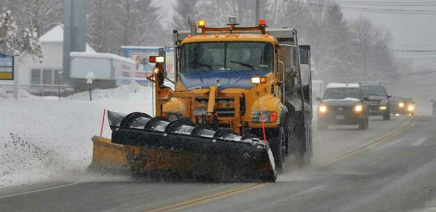 A state DOT truck plows on Route 9 in Saratoga Springs, NY  during a snowstorm on Wednesday January 12, 2011.  ( Philip Kamrass / Times Union ) Photo: Philip Kamrass