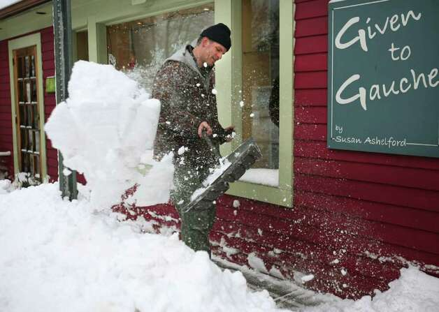 Bill Laslett of Milford shovels the sidewalk in front of a business on Daniel Street in downtown Milford on Wednesday, January 12, 2011. Photo: Brian A. Pounds / Connecticut Post