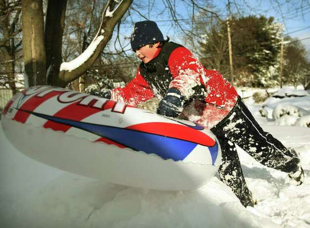 Jake Comeau, 12 of Milford, plays on his snow tube outside his home on Clayton Street in Milford on Wednesday, January 12, 2011. Photo: Brian A. Pounds / Connecticut Post