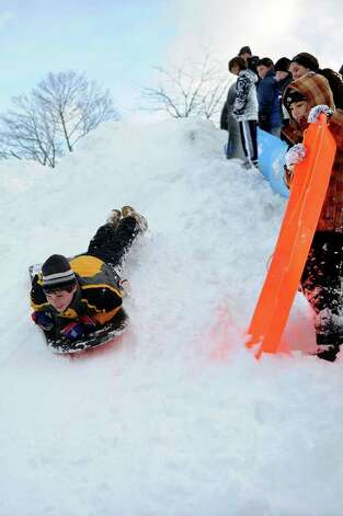 scott Yarmoff, 14, sleds off a giant mound of snow created by plows in the parking lot behind Greensfarms Elementary School in Westport on Wednesday, January 12, 2011. Photo: Lindsay Niegelberg / Connecticut Post