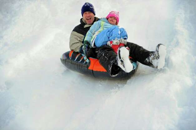 Mark Didio and his daughter, McKenzie, 6, sled behind Greensfarms Elementary School in Westport on Wednesday, January 12, 2011. Photo: Lindsay Niegelberg / Connecticut Post