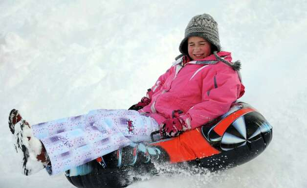 Isabella Didio, 10, sleds behind Greensfarms Elementary School in Westport on Wednesday, January 12, 2011. Photo: Lindsay Niegelberg / Connecticut Post
