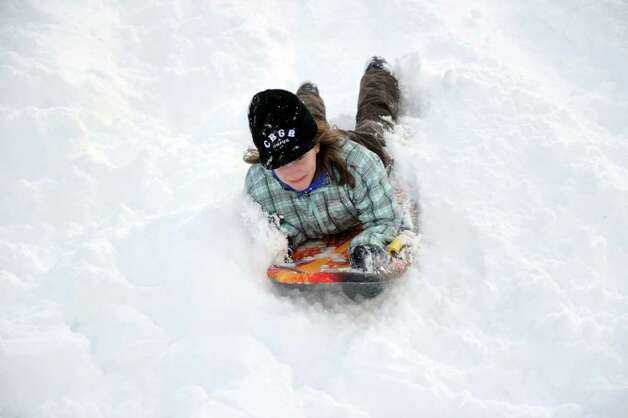 Hannah Debalsi, 12, sleds behind Greensfarms Elementary School in Westport on Wednesday, January 12, 2011. Photo: Lindsay Niegelberg / Connecticut Post