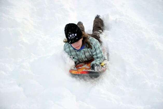 Hannah Debalsi, 12, sleds behind Greensfarms Elementary School in Westport on Wednesday, January 12, 2011. Photo: Lindsay Niegelberg / Connecticut Post