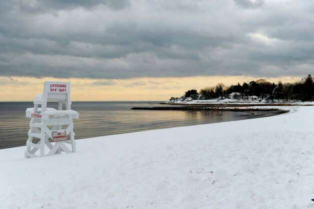 The snow and sunset create a serene scene in Westport on Wednesday, January 12, 2011. Photo: Lindsay Niegelberg / Connecticut Post