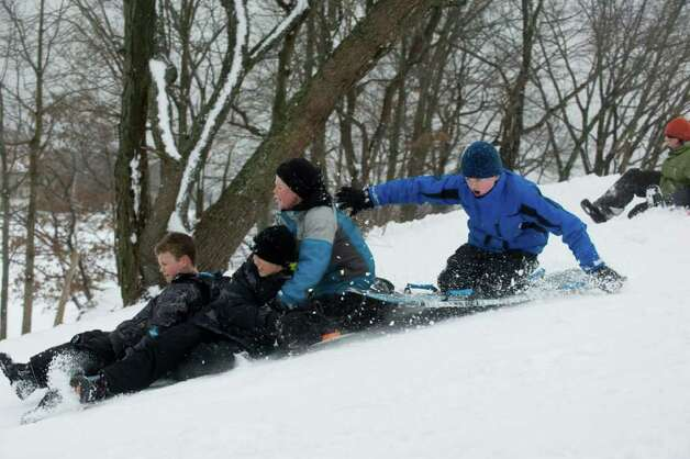 from left, Harrison Burns, Jack Ende, Keegan Bowes and William Marment find Cummings Park offers solid sledding after the storm in Stamford, Conn., Wednesday, January 12, 2011., January 12, 2011. Photo: Keelin Daly / Stamford Advocate