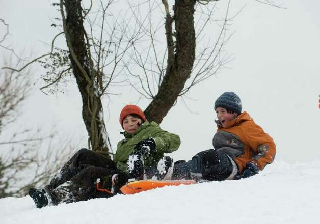 Noah Fine and Thomas Butler find Cummings Park offers solid sledding after the storm in Stamford, Conn., Wednesday, January 12, 2011., January 12, 2011. Photo: Keelin Daly / Stamford Advocate