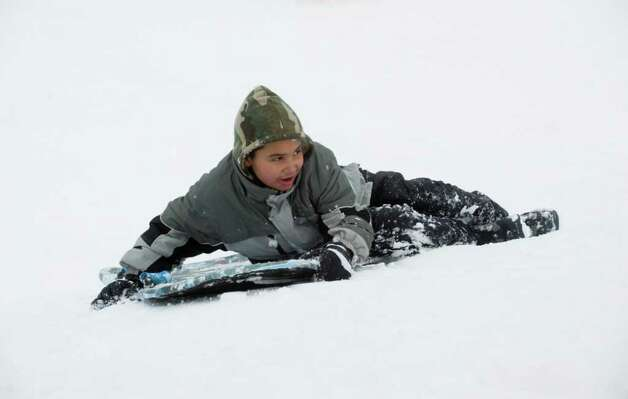 Daniel Guzman, 9, finds that Cummings Park offers solid sledding after the storm in Stamford, Conn., Wednesday, January 12, 2011., January 12, 2011. Photo: Keelin Daly / Stamford Advocate