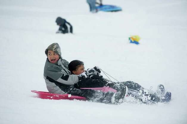 Daniel, 9, and Vivianna Guzman, 11, hit the slopes at Cummings Park  after the storm in Stamford, Conn., Wednesday, January 12, 2011., January 12, 2011. Photo: Keelin Daly / Stamford Advocate