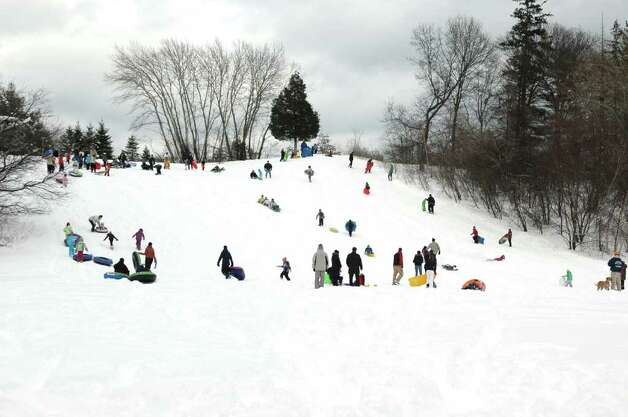 Sledders converged on the hill in Sturgess Park in Fairfield Conn. on Wednesday, Jan. 12, 2011. Photo: Cathy Zuraw / Connecticut Post