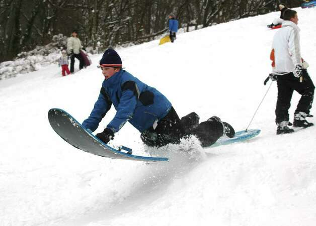 Steven Zembruski flies over a bump in the hill at Sturgess Park in Fairfield, Conn. on Wednesday, Jan. 12, 2011. Photo: Cathy Zuraw / Connecticut Post