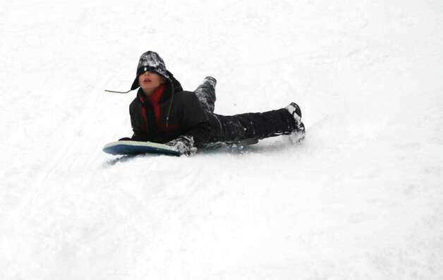 Stan Godlewski sleds down the hill at Surgess Park in Fairfield, Conn. on Wednesday, Jan. 12, 2011. Photo: Cathy Zuraw / Connecticut Post