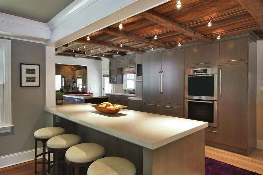 The Kitchen Is A Study In Contrasts, With Antique, Beamed Wood Ceilings,  Pale