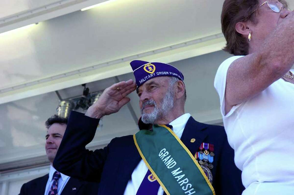 2010 Grand Marshal Phil Marzolf salutes during Norwalk's Memorial Day Parade from Veterans Memorial Park on Seaview Ave, along Van Zant Street and up East Avenue to the Town Green, Monday May 31, 2010.