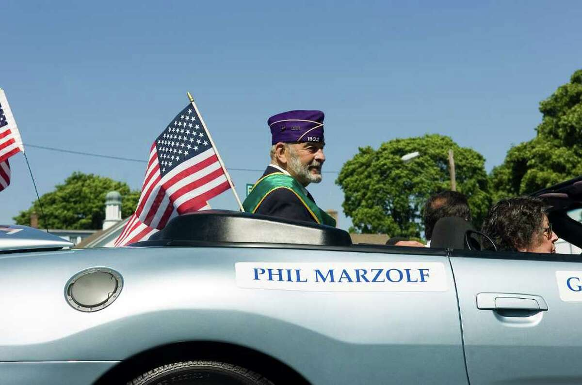 Norwalk's 2010 Grand Marshal Phil Marzolf, a US Navy veteran who was wounded while serving as a corpsman with the US Marines in the Korean War rides along the route during the Memorial Day Parade from Veterans Memorial Park on Seaview Ave, along Van Zant Street and up East Avenue to the Town Green, Monday May 31, 2010.