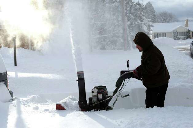 Aftermath and cleanup around Derby, Conn. from a big snowstorm that hit all of New England overnight on Wednesday January 12, 2011. Phil Soderberg, uses his snowblower to clear the driveway at a home along Ridge Road in Derby. Photo: Christian Abraham / Connecticut Post