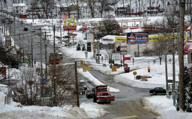 Aftermath and cleanup around Derby, Conn. from a big snowstorm that hit all of New England overnight on Wednesday January 12, 2011. A view of Division Street in Derby. Photo: Christian Abraham / Connecticut Post