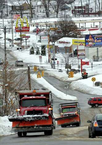 Aftermath and cleanup around Derby, Conn. from a big snowstorm that hit all of New England overnight on Wednesday January 12, 2011. A view of plow trucks coming up Division Street in Derby. Photo: Christian Abraham / Connecticut Post