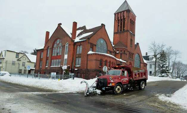 Aftermath and cleanup around Derby, Conn. from a big snowstorm that hit all of New England overnight on Wednesday January 12, 2011. Photo: Christian Abraham / Connecticut Post
